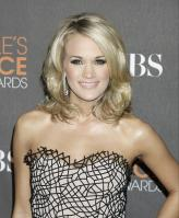 49558_celebrity-paradise.com-The_Elder-Carrie_Underwood_2010-01-06_-_36th_annual_People8s_Choice_Awards_862_122_398lo.jpg