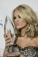 49739_celebrity-paradise.com-The_Elder-Carrie_Underwood_2010-01-06_-_36th_annual_People1s_Choice_Awards_8200_122_575lo.jpg