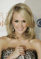 49884_celebrity-paradise.com-The_Elder-Carrie_Underwood_2010-01-06_-_36th_annual_People7s_Choice_Awards_6221_122_569lo.jpg