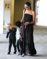 20725_Celebutopia-Angelina_Jolie_taking_daughters_to_a_kid_center_in_a_mall_in_LA-14_122_504lo.JPG