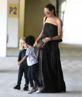 24010_Celebutopia-Angelina_Jolie_taking_daughters_to_a_kid_center_in_a_mall_in_LA-13_122_247lo.JPG