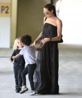 24055_Celebutopia-Angelina_Jolie_taking_daughters_to_a_kid_center_in_a_mall_in_LA-16_122_88lo.JPG