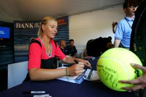 Maria Sharapova giving autographs