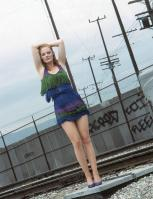 105982299_37835d1169288019-marge-helgenberger-very-short-bluish-fringed-dress-blue-high-heels-marg_helgenberge.jpg