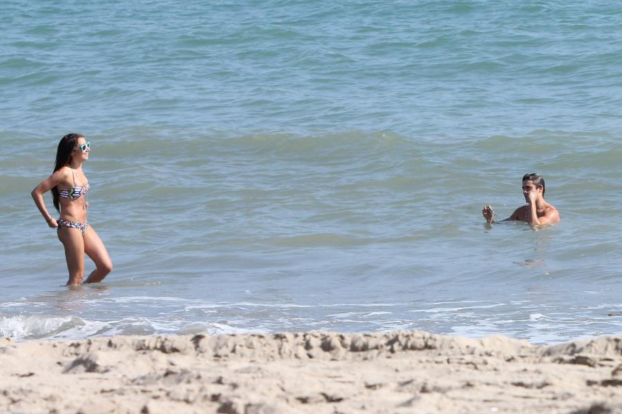 662078673_UploadedByKurupt_Ashley_Tisdale_At_The_Beach_in_Malibu_July02_2011_01_122_176lo.jpg