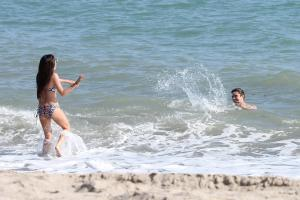 662132552_UploadedByKurupt_Ashley_Tisdale_At_The_Beach_in_Malibu_July02_2011_02_122_424lo.jpg