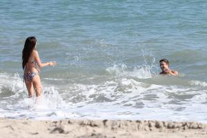 662180428_UploadedByKurupt_Ashley_Tisdale_At_The_Beach_in_Malibu_July02_2011_03_122_172lo.jpg