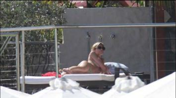 Abbey Clancy sunbathing topless