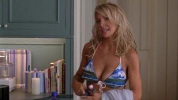 Barbara Alyn Woods in bikini going to the pool