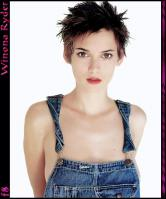 Winona Ryder posing in dungarees