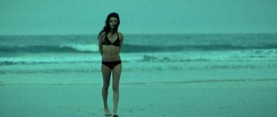 Mila Kunis in bikini on the beach