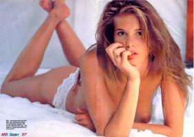 Elle Macpherson topless on the bed